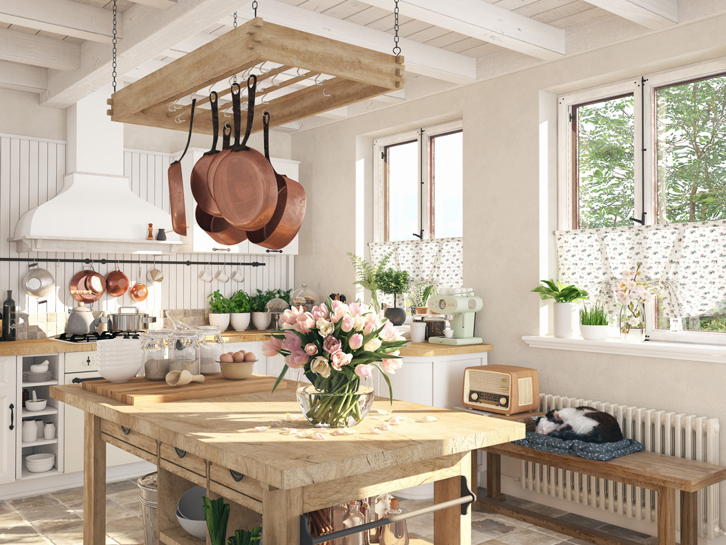 An image of a vintage kitchen with pink roses on the table