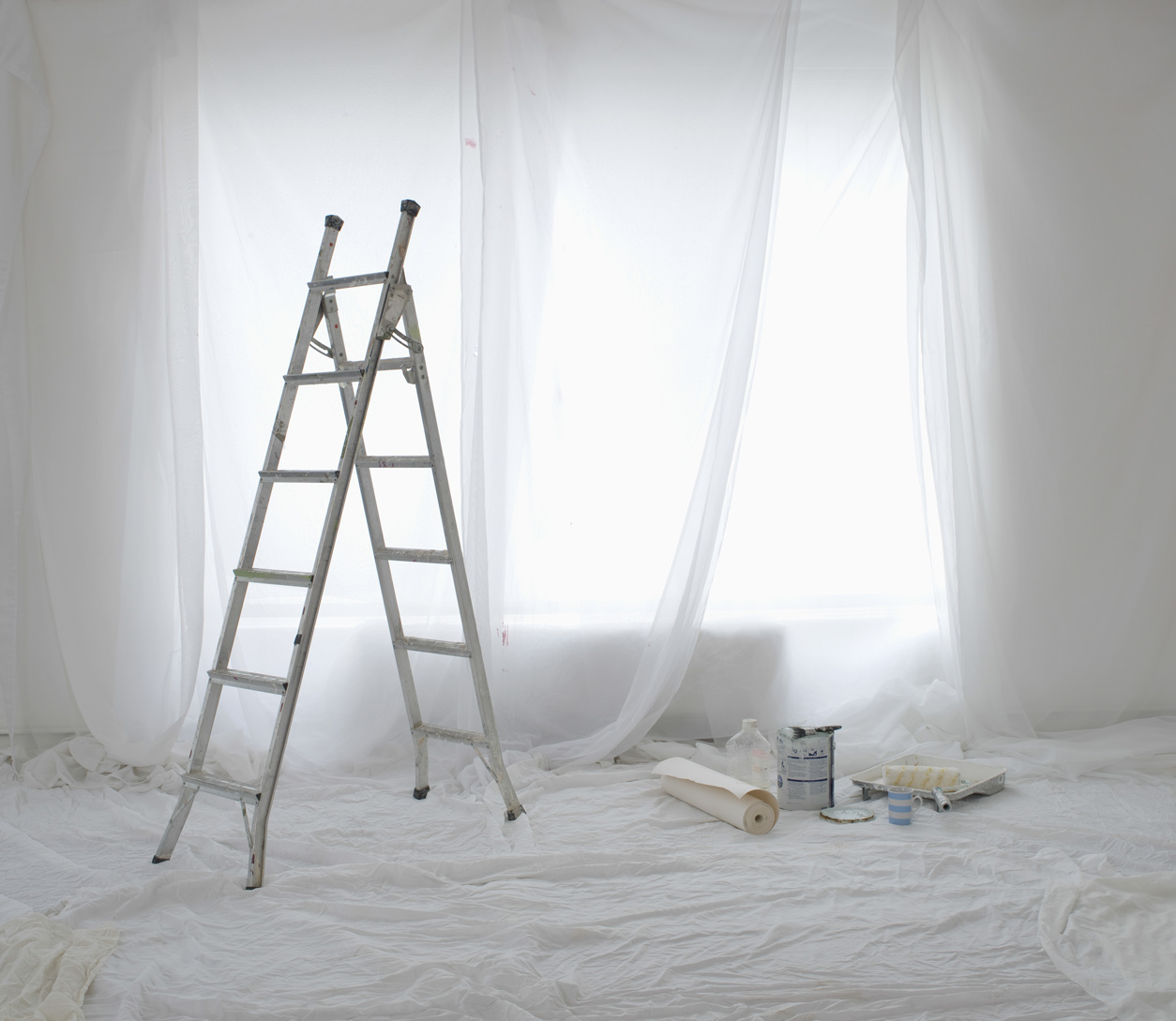 White ladder and curtains